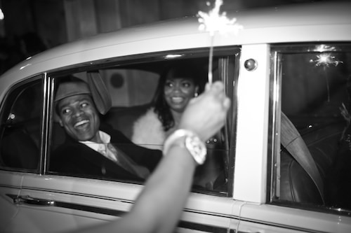 Bride and Groom in GetAway Car at Sparkler Exit. Howerton+Wooten Events.