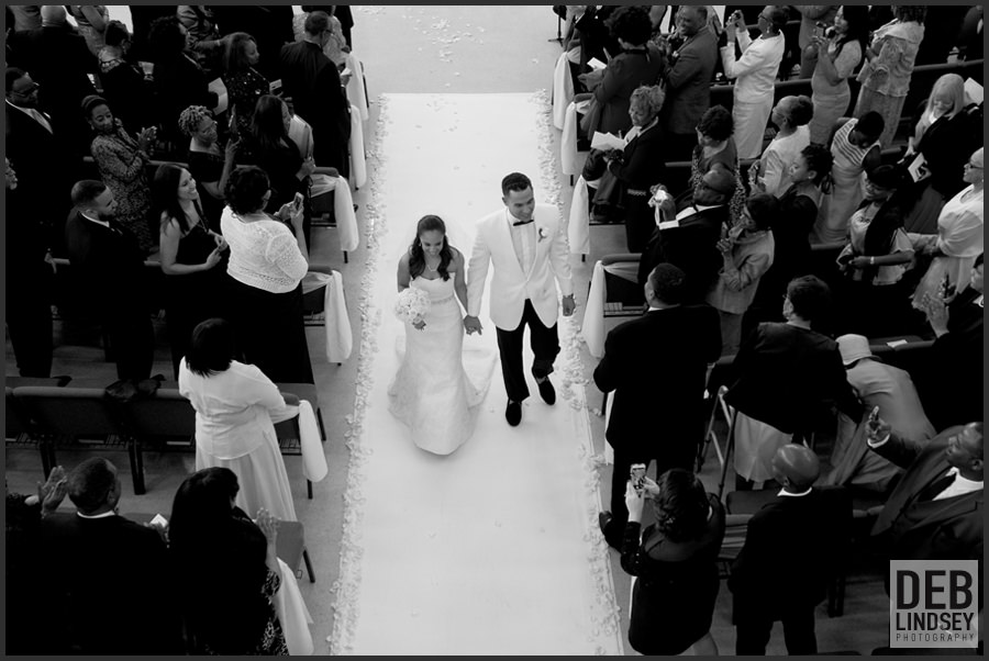 Bride and Groom walking down the aisle. Howerton+Wooten Events.