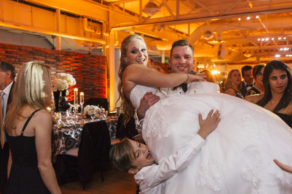 Groom Carrying Bride. Howerton+Wooten Events.
