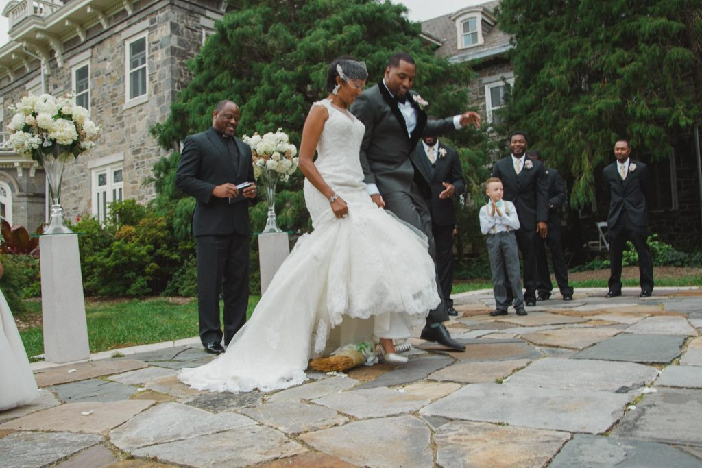 Bride and Groom Jumping the Broom at Cylburn Arboretum. Howerton+Wooten Events.