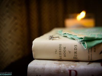 Engagement Ring on a Stack of Books. Howerton+Wooten Events