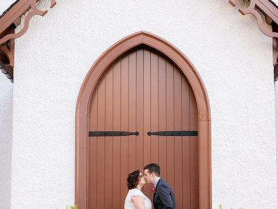 Bride and Groom in Doorway at Lincoln Cottage. Howerton+Wooten Events.