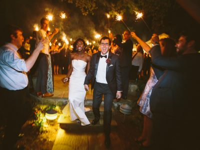 African American Bride and Caucasian Groom Sparkler Exit at Airlie. Howerton+Wooten Events.