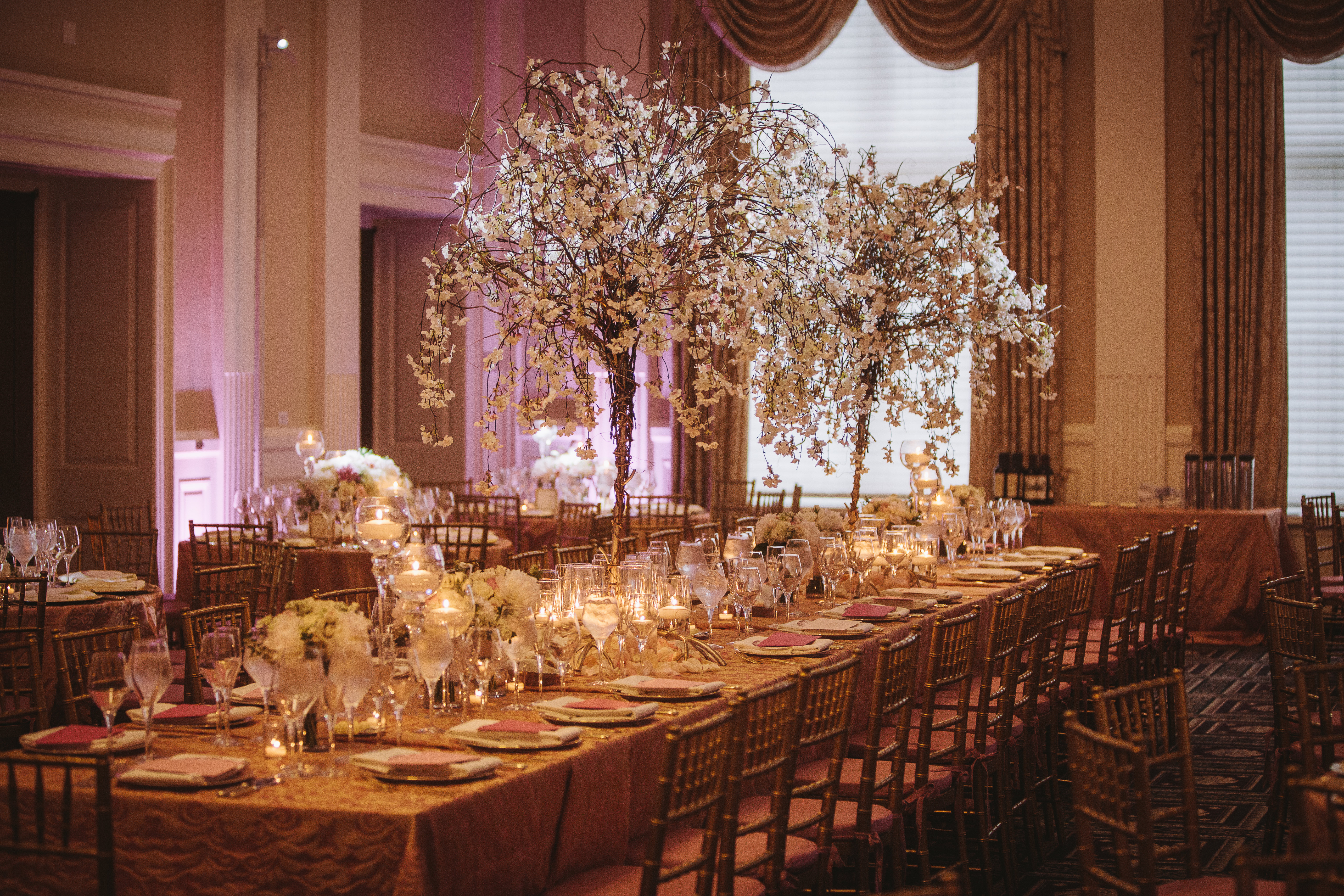 Cherry Blossoms on a Blush and Gold Table at Carnegie. Howerton+Wooten Events.