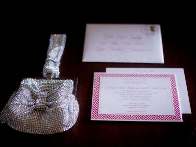 Pink Invitation and Purse. Howerton+Wooten Events.