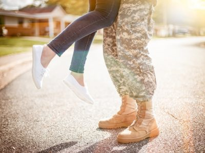 Military Couple Kissing. Howerton+Wooten Events.