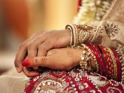 Indian Bride and Groom Holding Hands. Howerton+Wooten Events.