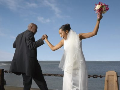 African American Bride and Groom Celebrating. Howerton+Wooten Events.